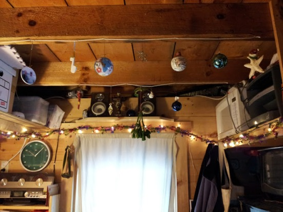 Ornaments hung from clothesline stapled to the underside of beams